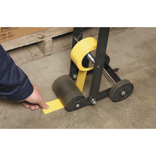 Line marking tape applicator
