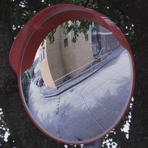 Budget outdoor traffic mirror with hood