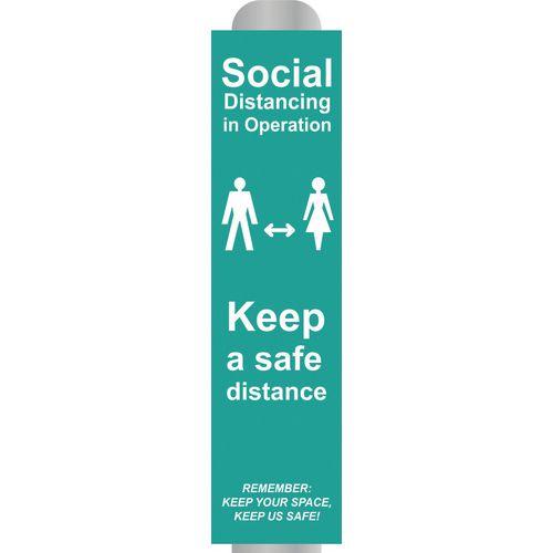 Social distancing in operation post /bollard signs