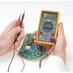 Manual ranging digital multimeter with thermocouple wire probe, 2 test leads and battery