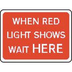 Warning information & regulation signs - When red light shows wait here