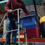 Hook-on container for retractable wheel warehouse step with high handrail